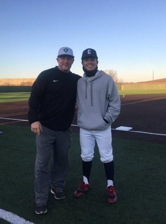 Coach Trent Mongero with one of his baseball mentees